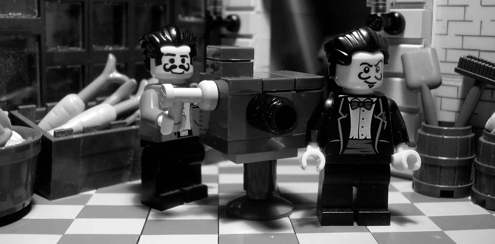 Two lego men with a film camera