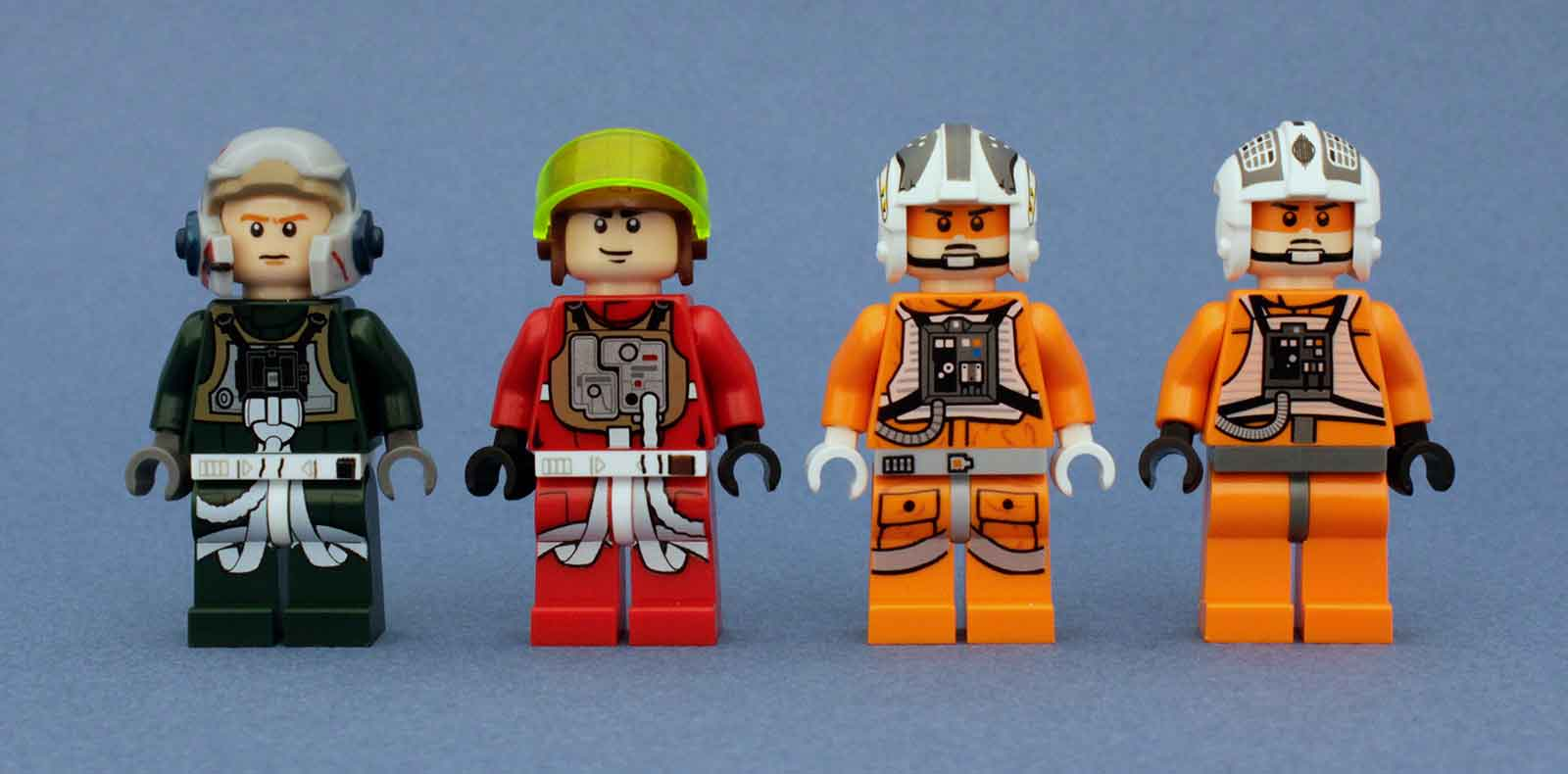 Four Lego Star Wars Rebel Alliance pilots in a row